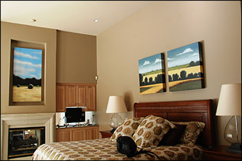 "Commissioned paintings in client's home. Oil on canvas. On left, ""While the sun shines."" On the right, the diptych ""Summer Fields Gentry County."""
